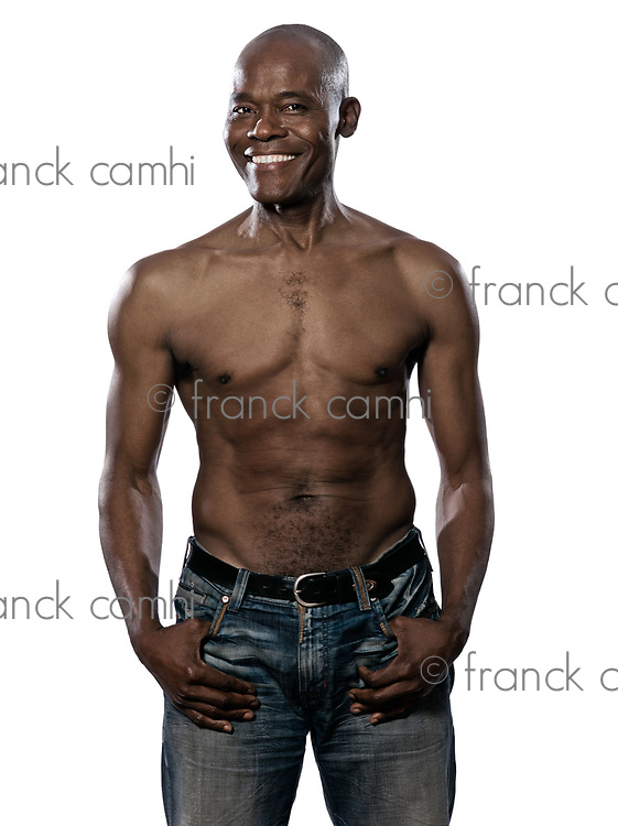 Portrait of a cool shirtless fit Afro American mature man isolated on white background