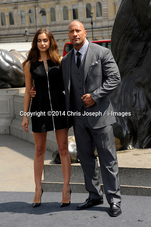 Image ©Licensed to i-Images Picture Agency. 02/07/2014. London, United Kingdom. Irina Shayk & Duane Johnson attends a photocall for 'Hercules' at Trafalgar Square. Picture by Chris Joseph / i-Images