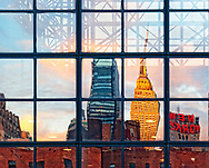 MANHATTAN - OCT. 29: Empire State Building and New Yorker Hotel with its red name sign Reflected at Dusk in Javits Center Windows on 11th Avenue and 35th Street, in New York City, on October 29, 2010.  (Not digitally altered)