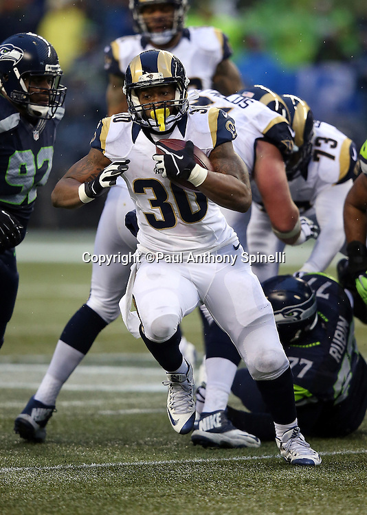 St. Louis Rams running back Todd Gurley II (30) runs for a fourth quarter gain of 9 yards during the 2015 NFL week 16 regular season football game against the Seattle Seahawks on Sunday, Dec. 27, 2015 in Seattle. The Rams won the game 23-17. (©Paul Anthony Spinelli)