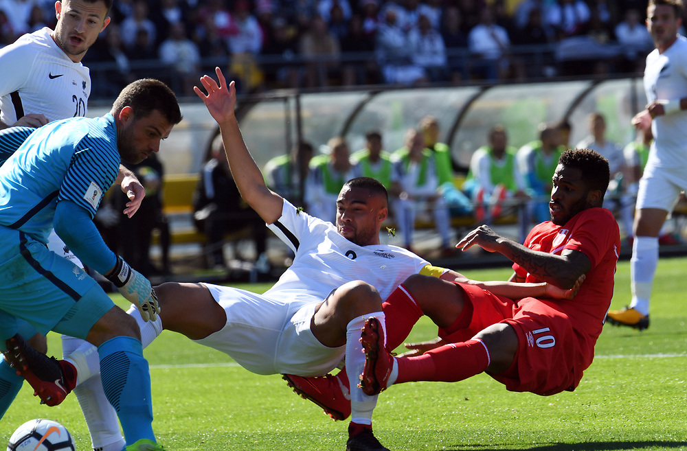 New Zealand's Winston Reid, centre, tangles with Peru's Jefferson Farfan, right, as the ball goes pass the keeper, New Zealand's Stefan Narinovic in the Soccer World Cup qualifying match, Westpac Stadium, Wellington, New Zealand, Saturday, November 11, 2017. Credit:SNPA / Ross Setford  **NO ARCHIVING**