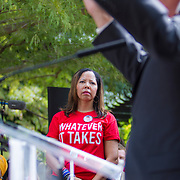 "Lucy McBath, listens as Virginia Governor, Terry McAuliffe speaks at a rally organized to support victims of gun violence and pressure politicians to do ""whatever it takes"" to prevent gun violence.  McBath lost her son to gun violence when Michael Dunn fired a gun into a car with her son and several other teenagers back in November 2012.  Andy Parker, made his first visit to Washington, D.C. since his daughter, WDBJ_TV reporter, Alison Parker, was shot and killed on live television near Roanoke, VA last week.  The rally, organized by Everytown for Gun Safety, brought Parker together with Virginia Senators, Mark Warner, Tim Kaine and Virginia Governor, Terry McAuliffe near the United States Capitol, on Thursday, September 10, 2015.  John Boal/for The New York Daily News"