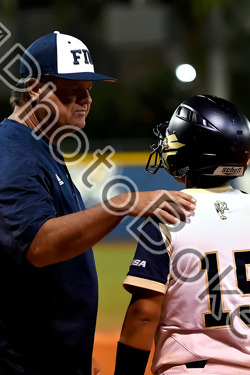 2018 February 09 - FIU's head coach Gator Rebhan and Venessa Gallegos (15). Florida International University softball fell to Hofstra, 5-0, at Felsberg Field, Miami, Florida. (Photo by: Alex J. Hernandez / photobokeh.com) This image is copyright by PhotoBokeh.com and may not be reproduced or retransmitted without express written consent of PhotoBokeh.com. ©2018 PhotoBokeh.com - All Rights Reserved