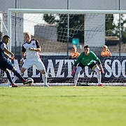 09 September 2018: San Diego State Aztecs goal keeper Cameron Hogg (01) attempts to block a shot from UC Irvine midfielder Alvaro Quezada (14) in the first half. The San Diego State men's soccer team beat UC Irvine in overtime 2-1 Sunday afternoon at the SDSU Sports Deck.