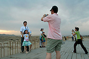 Chinese family taking pictures in Taklamakan desert, China