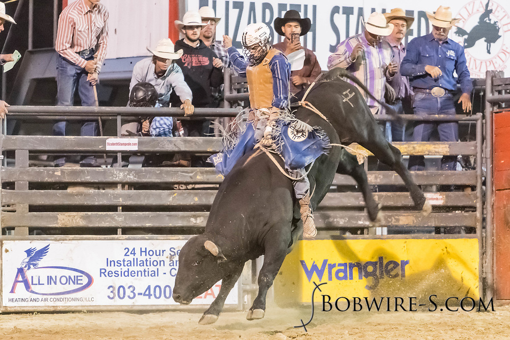 Bull rider Cody Strite rides Summit Pro Rodeo's Song N Dance in the second performance of the Elizabeth Stampede on Saturday, June 2, 2018.