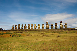 Chile, Easter Island: Array of statues or moai on a platform or ahu at Ahu Tongariki, near the quarry Rano Raruku.  This is the largest array of moia on Easter Island, consisting of 15 moai..Photo #: ch245-32719.Photo copyright Lee Foster www.fostertravel.com lee@fostertravel.com 510-549-2202