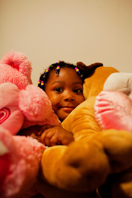 """Roger """"Winky"""" Williams' daughter, Cameariyana, 4, poses in her home in the Baptist Town neighborhood of Greenwood, Mississippi on February 16, 2011."""