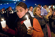 November 10, 2008 -- PHOENIX, AZ:  A woman holds up candles during a gay rights vigil in Phoenix, AZ, Monday. About 250 people attended a candle light vigil in support of gay rights and gay marriage in Phoenix, AZ, Monday night. The rally, like similar ones in Los Angeles and Salt Lake City, were in response to anti-gay marriage and anti-gay rights initiatives that were passed by the voters in Arizona, California and Florida. The anti-gay initiatives in Arizona and California were funded by conservative churches, including the Church of Latter Day Saints (Mormons). Photo by Jack Kurtz / ZUMA Press