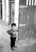 Young boy at gate