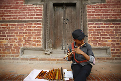 June 21, 2017 - Lalitpur, Nepal - A Nepalese boy plays flute for a customer on the occasion of World Music Day which has evolved to explore new musical trends and music from across the world to revive traditional music at Patan Durbar Square in Lalitpur, Nepal on June 21, 2017. (Credit Image: © Skanda Gautam via ZUMA Wire)