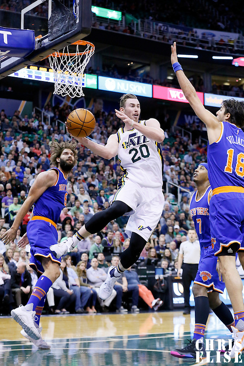 09 December 2015: Utah Jazz forward Gordon Hayward (20) passes the ball around New York Knicks guard Sasha Vujacic (18) during the Utah Jazz 106-85 victory over the New York Knicks, at the Vivint Smart Home Arena, Salt Lake City, Utah, USA.