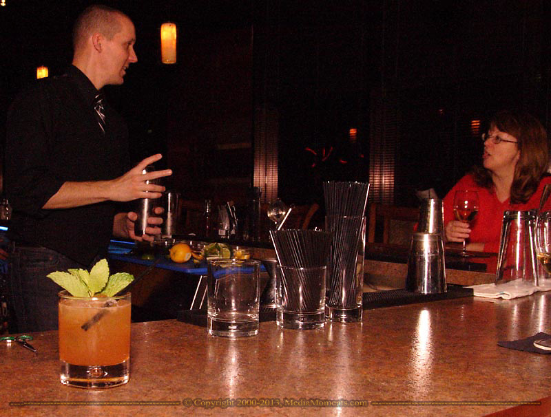 A Whisky Smash sits ready for pickup, made by bartender Garrett Hansbury, from Centerville (left) as he talks with Tammy Hopper, from Dayton talk at SideBar lounge, in the First National Plaza in downtown Dayton, Friday, November 7, 2008.