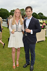 The HON.GEORGE CADOGAN and DAVINA MOTION at the Cartier Queen's Cup Final 2016 held at Guards Polo Club, Smiths Lawn, Windsor Great Park, Egham, Surry on 11th June 2016.