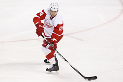 November 30, 2010; San Jose, CA, USA;  Detroit Red Wings defenseman Ruslan Salei (24) passes the puck against the San Jose Sharks during the first period at HP Pavilion. Detroit defeated San Jose 5-3. Mandatory Credit: Jason O. Watson / US PRESSWIRE