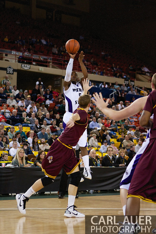 November 26th, 2010:  Anchorage, Alaska - Jordan Richardson (5), a freshman guard for Weber State elevates over the Sun Devil defense for a shot attempt in the Wildcats 58-59 loss to Arizona State at the Great Alaska Shootout.