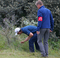 England's Justin Rose looks for his ball on the 5th during day three of The Open Championship 2017 at Royal Birkdale Golf Club, Southport.