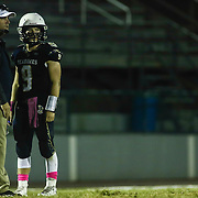 Delaware Military Academy Head coach Michael Ryan, LEFT, and quarterback Jacob Hudson (9), RIGHT,  talk to each other during a Week 8 DIAA football game between Laurel and Delaware Military Academy Saturday, Oct. 29, 2016, at Baynard Stadium in Wilmington.