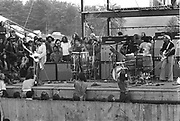 Jimi Hendrix playing his electric guitar and singing right after dawn at the Woodstock rock festival at Max Yasgur's 600 acre farm, in the rural town of Bethel, NY, on August 18, 1969.