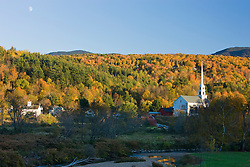 The moon, a church, and fall foliage in Stowe, Vermont.