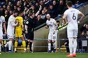 Marcus Maddison of Peterborough United receives a yellow card during the EFL Sky Bet League 1 match between Oxford United and Peterborough United at the Kassam Stadium, Oxford, England on 16 February 2019.