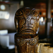 San Francisco, California: Trader Vics Restaurant serves Asian Island-style food in their restaurant designed with original Tiki-inspired decor, including many wooden tikis. Jan. 2005 (photo: Ann Summa).
