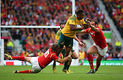 Australia's centre Tevita Kuridrani getting tackled by Wales Dan Biggar during the Rugby World CupPool A match between Australia and Wales at Twickenham, Richmond, United Kingdom on 10 October 2015. Photo by Matthew Redman.
