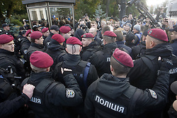 October 4, 2018 - Kiev, Ukraine - Police stand guard as activists try to approach to the Parliament building during a rally organized by the workers union of the National Academy of Sciences near the Ukrainian Parliament in Kiev, Ukraine 04 October 2018. Activists try to draw attention to the problems of underfunding of the National Academy of Sciences,acording the activists. (Credit Image: © Str/NurPhoto/ZUMA Press)