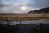 A bench by Seljalandsfoss waterfall, South Iceland.