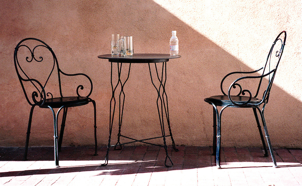 Chairs and table sit in shade, Santa Fe New Mexico