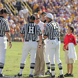 25 October 2008:  Georgia Head Coach meets with officials over a call during the Georgia Bulldogs 52-38 victory over the LSU Tigers at Tiger Stadium in Baton Rouge, LA.