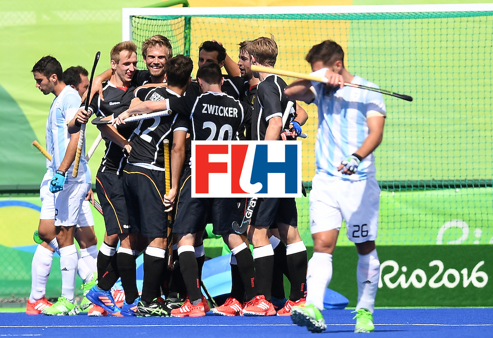 Germany players celebrate a goal during the men's field hockey Argentina vs Germany match of the Rio 2016 Olympics Games at the Olympic Hockey Centre in Rio de Janeiro on August, 11 2016. / AFP / MANAN VATSYAYANA        (Photo credit should read MANAN VATSYAYANA/AFP/Getty Images)
