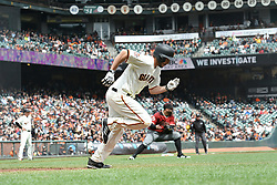 April 11, 2018 - San Francisco, CA, U.S. - SAN FRANCISCO, CA - APRIL 11:San Francisco Giants Starting Pitcher Andrew Suarez (59) gets his first base hit with a bunt during the game between the Arizona Diamondbacks and the San Francisco Giants on Wednesday, April 11, 2018 at AT&T Park in San Francisco, CA (Photo by Douglas Stringer/Icon Sportswire) (Credit Image: © Douglas Stringer/Icon SMI via ZUMA Press)