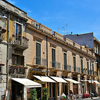 Via Primo Settembre in Messina, Italy<br /> Most of the major sites to see in old town Messina are in a pie-shaped wedge formed by Via Giuseepe Garibaldi, which is parallel to the harbor, and Corsa Cabour to the west. The third major street is Via Primo Settembre shown here. Its name honors September 1, 1848, when Neapolitan's fleet began bombarding Messina in retaliation for the Sicilian revolution for independence. During the next five days, the Bourbons proceeded to level the town.