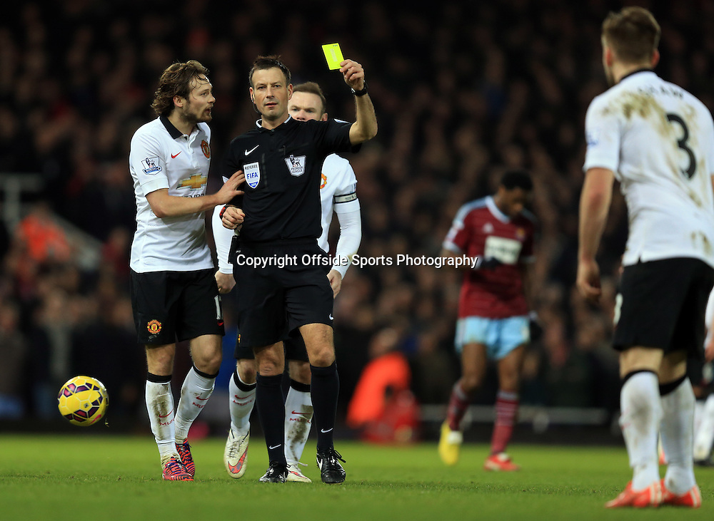 8 February 2015 - Barclays Premier League - West Ham United v Manchester United - Luke Shaw of Manchester United is shown his 1st yellow card by referee, Mark Clattenburg - Photo: Marc Atkins / Offside.