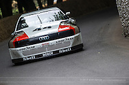 Chichester, UK - July 2013: Audi 200 Trans-Am passes the flint wall in action at the Goodwood Festival of Speed on July 12, 2013.