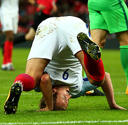 Harry Kane of England lands on his head after scoring the winning goal against Slovenia to make it 1-0 - Mandatory by-line: Robbie Stephenson/JMP - 05/10/2017 - FOOTBALL - Wembley Stadium - London, United Kingdom - England v Slovenia - World Cup qualifier