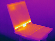 Thermogram of a laptop computer.  The different colors represent different temperatures on the object. The lightest colors are the hottest temperatures, while the darker colors represent a cooler temperature.  Thermography uses special cameras that can detect light in the far-infrared range of the electromagnetic spectrum (900?14,000 nanometers or 0.9?14 µm) and creates an  image of the objects temperature..