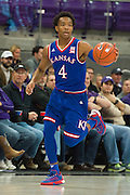 FORT WORTH, TX - FEBRUARY 6: Devonte' Graham #4 of the Kansas Jayhawks brings the ball up court against the TCU Horned Frogs on February 6, 2016 at the Ed and Rae Schollmaier Arena in Fort Worth, Texas.  (Photo by Cooper Neill/Getty Images) *** Local Caption *** Devonte' Graham