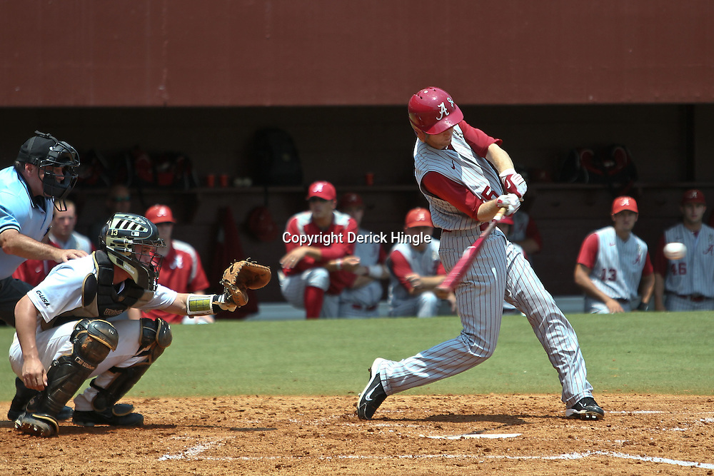 June 03, 2011; Tallahassee, FL, USA;  Alabama Crimson Tide second baseman Josh Sanders (35) hits a sacrifice fly to score a run during the fourth inning against the UCF Knights in the 2011 Tallahassee Regional at Dick Howser Stadium. Alabama defeated UCF 5-3.  Mandatory Credit: Derick E. Hingle