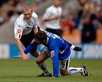 Photo: Henry Browne.<br /> Leicester City v Luton. Coca Cola Championship.<br /> 27/08/2005.<br /> Warren Feeney of Luton is knocked over by Patrick McCarthy of City.