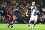 """West Bromwich Albion forward Charlie Austin (15) looks to release the ball  under pressure from Reading midfielder (on loan from AS Monaco) Judilson Gomes """"Pele"""" (29) during the EFL Sky Bet Championship match between West Bromwich Albion and Reading at The Hawthorns, West Bromwich, England on 21 August 2019."""