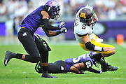 FORT WORTH, TX - SEPTEMBER 13:  Chris Streveler #5 of the Minnesota Golden Gophers is brought down by Chris Hackett #1 against the TCU Horned Frogs on September 13, 2014 at Amon G. Carter Stadium in Fort Worth, Texas.  (Photo by Cooper Neill/Getty Images) *** Local Caption *** Chris Streveler; Chris Hackett