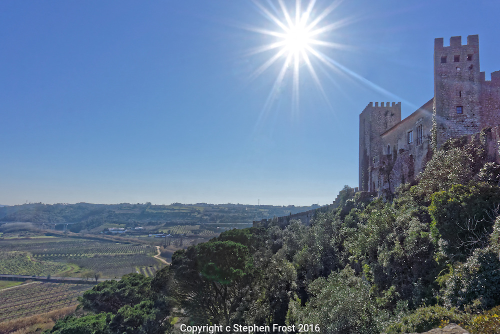 A sun-baked view from the medieval walled city of Óbidos over the countryside of Oeste in Portugal.