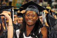 Students turn their tassels during the 29th annual Kettering Fairmont High School commencement at the Nutter Center in Fairborn, Thursday, May 31, 2012.