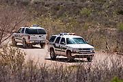 12 APRIL 2005 - DOUGLAS, AZ: Border Patrol vehicles patrol the border road that runs along the US - Mexico border between Douglas, AZ and Naco, AZ. PHOTO BY JACK KURTZ