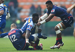 Cape Town-180427 Rebels Billy Meakes tackles Stomers captain Siya Kolisi when the two teams played the super 15 match at newlands Stadium .photograph:Phando Jikelo/African News Agency/ANA