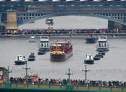 River Pageant with a flotilla of a 1,000 boats accompanying The Queen and the Royal Family down the Thames to mark the Queen's Diamond Jubilee. Sunday June 3, 2012. Photo by Andrew Parsons/i-Images