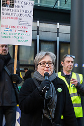 London, UK. 22nd January, 2019. Caroline Russell, Green Party London Assembly Member, addresses Support staff at the Department for Business, Energy and Industrial Strategy (BEIS) represented by the Public and Commercial Services (PCS) union on the picket line after beginning a strike for the London Living Wage of £10.55 per hour and parity of sick pay and annual leave allowance with civil servants. The strike is being coordinated with receptionists, security staff and cleaners at the Ministry of Justice (MoJ) represented by the United Voices of the World (UVW) trade union.