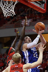 21 February 2018:  Casey Schlatter doubled on by Milik Yarbrough and Isaac Gassman during a College mens basketball game between the Drake Bulldogs and Illinois State Redbirds in Redbird Arena, Normal IL